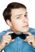Handsome old-fashioned gentleman adjusting his bow tie Stock Photos