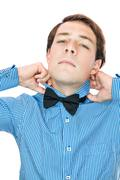 Handsome old-fashioned gentleman adjusting his bow tie - stock photo