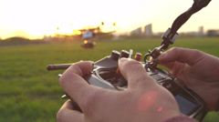 SLOW MOTION: Flying a multicopter with transmitter - stock footage