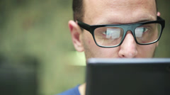 man with glasses working on a tablet - stock footage