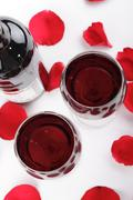 wine and rose petals - stock photo