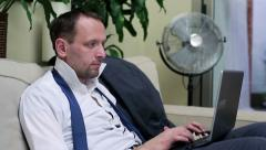 Businessman working on tablet and sitting on the sofa at home Stock Footage