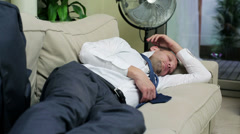 young businessman taking a nap on the sofa - stock footage