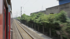 A train moves along railroad tracks , xi'an, shaanxi, china Stock Footage
