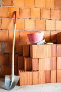 Masonry Shovel bucket and bricks Stock Photos