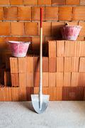 Masonry bricks, Shovel and buckets - stock photo