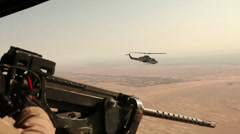 War in Afghanistan - Helicopters next to each other with door gunner on partrol - stock footage