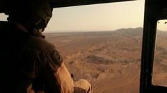 War in Afghanistan - Helicopter Door Gunner Stock Footage