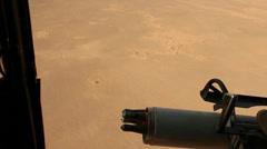 War in Afghanistan - Helicopter Door Gun in flight Stock Footage