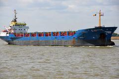 A ship navigating on a river - stock photo