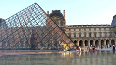 Pyramid and fountain louvre museum sunny day Stock Footage
