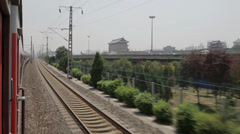 An electrified passenger train moves through Xi'an city ,xi'an, shaanxi, china Stock Footage