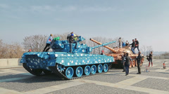 Kids playing on the colorful tanks Stock Footage