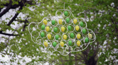 Easter eggs decorations in the trees, symbol, metal frame, handy craft, outdoors Stock Footage