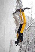 Climbing ice ax in the white ice Stock Photos