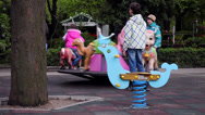 Stock Video Footage of Children's playground, happy kids riding Merry go round, carousel, park
