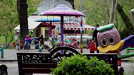 Stock Video Footage of Children's playground, kids and parents in the park, carousel, spring