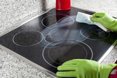 Cleaning the hob - stock photo