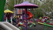 Stock Video Footage of Children's playground, Merry go round, empty carousel, horses, park, springtime