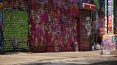 Graffiti on city street - stock footage