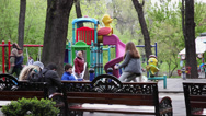 Stock Video Footage of Children's playground, kids and parents in the park, seesaw, spring