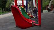 Stock Video Footage of Two empty swings moving on the playground, park, spring season