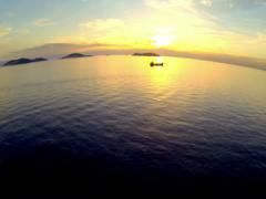 Take off and fly over Marmara Sea towards Princes Islands at sunset 1080p Stock Footage