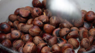 Stock Video Footage of Roasting sweet chestnuts, cooked nuts, street vendor, hot food