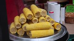Selling sweet corn cobs, street vendor, healthy vegetarian food - stock footage