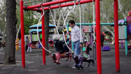 Stock Video Footage of Children's playground, kids and parents in the park, spring
