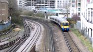 Stock Video Footage of London two trains pass by underground and overground train
