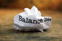 balance crinkled paper - stock photo