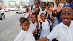 Caribbean school kids at play Stock Footage