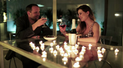 Young couple drinking wine and feeding each other with Stock Footage