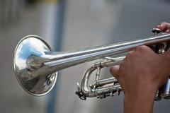 Man playing the silver trumpet Stock Photos
