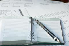 agenda of activities with accounting papers - stock photo
