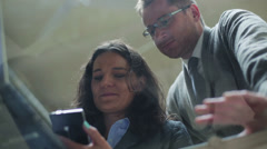 Businesspeople working on cellphone and enjoying time together Stock Footage