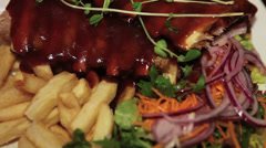 Close up of Pork Ribs and fries Restaurant food Stock Footage