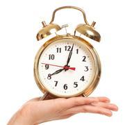 Alarm clock in woman's hand Stock Photos