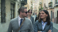 Businesspeople walking together on the street, steadycam shot Stock Footage