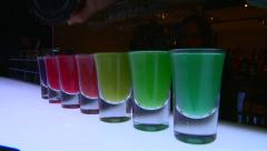 Shots glasses changing color - stock footage