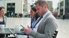 Businesspeople having break in street cafe and talking, steadycam shot Stock Footage
