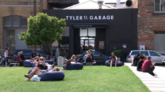 Wide angle of people relaxing in Britomart, Auckland Stock Footage