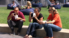 Close ups of people relaxing in Britomart, Auckland Stock Footage