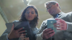 Business people using laptop and cellphone in the office Stock Footage