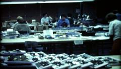 1059 - women at work in computer factory - vintage film home movie - stock footage