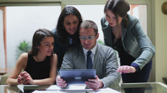 Business people working together on tablet in the office, steadycam shot Stock Footage