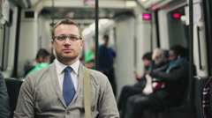 Pensive businessman riding by the subway, steadycam shot - stock footage