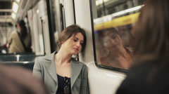 Sad woman sitting in the subway, steadycam shot Stock Footage