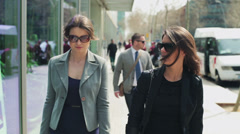 Businesswoman enjoying time together in the street, steadycam shot Stock Footage